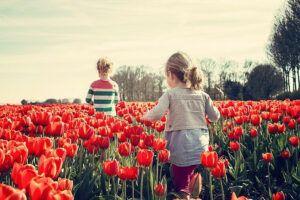 Children in field of flowers