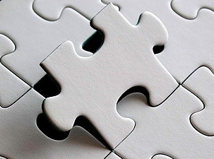 White puzzle piece fitting in