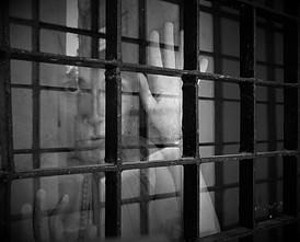 Woman behind a barred window