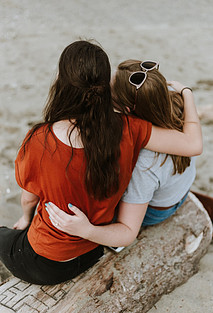 Two friends holding each other